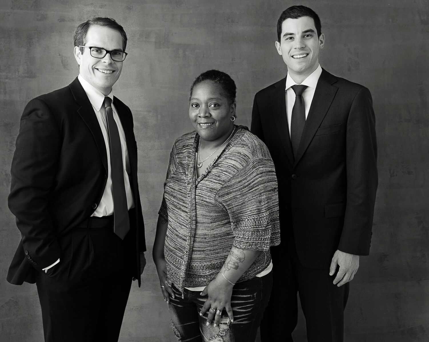 Crystal Taylor with Jonathan Porter (left) and Elliot Weingarten (right) of Simpson Thacher & Bartlett LLP