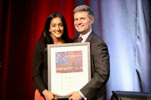 Vanita Gupta accepts the Servant of Justice Award from Legal Aid Executive Director Eric Angel